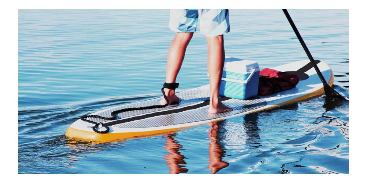Paddleboarder wearing ankle leash on SUP
