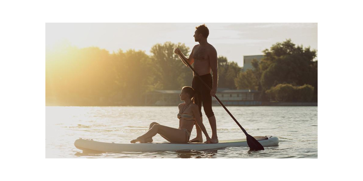 Paddling couple on stand-up paddle board with SUP paddle