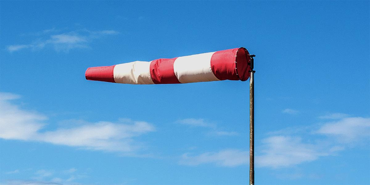 WIndsock blowing at beach indicating wind speed and direction