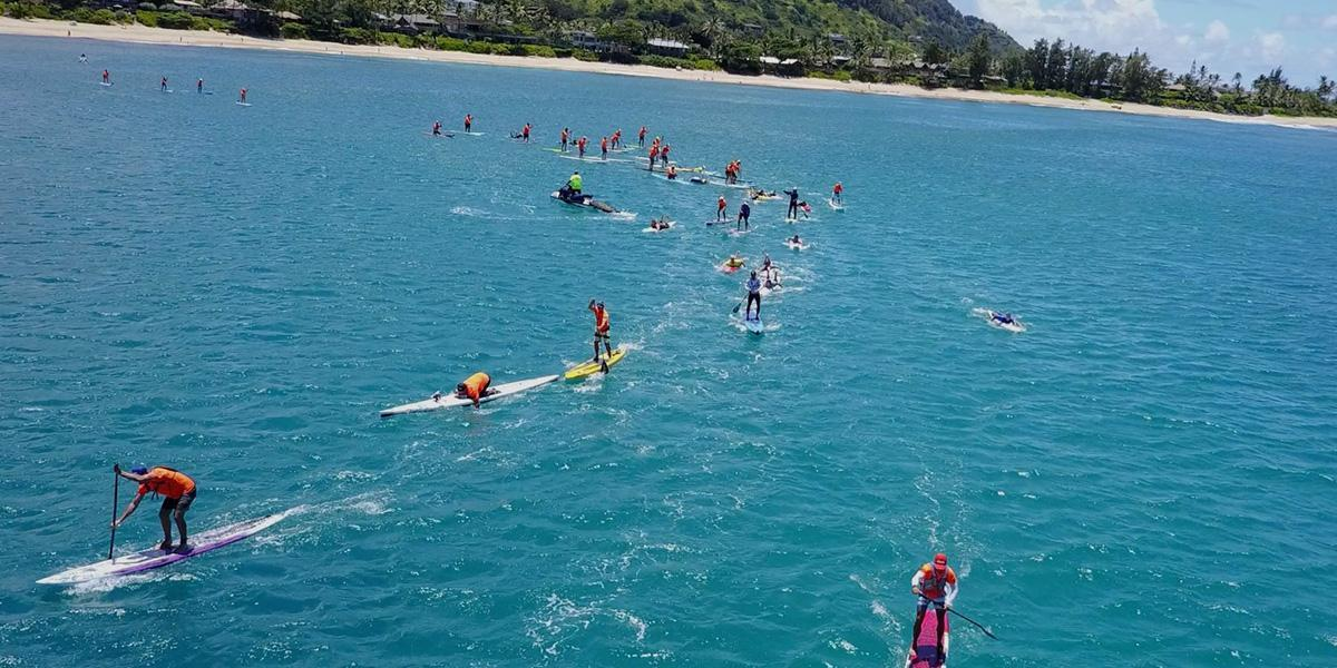 SUP paddlers negotiating bend on coastal racing course