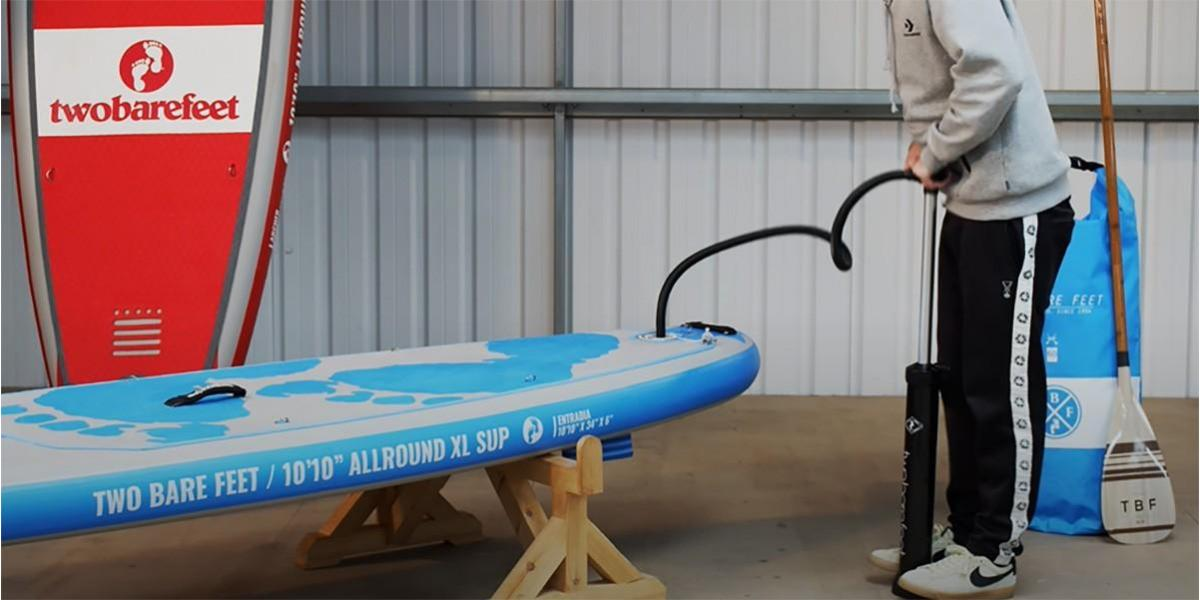 pumping-up-inflatable-paddleboard